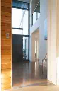 Roomy Home polished concrete interior floor pocket sliding doors into entrance hall McCann Moore Architects