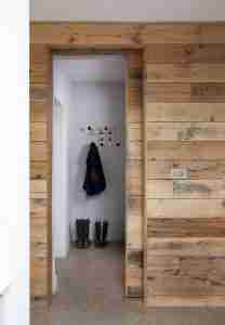 Roomy Home polished concrete interior floor reclaimed timber sliding door to boot room McCann Moore Architects