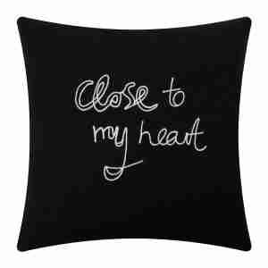 Roomy home interiors with heart Amara Bella Freud close to my heart cushion black £160